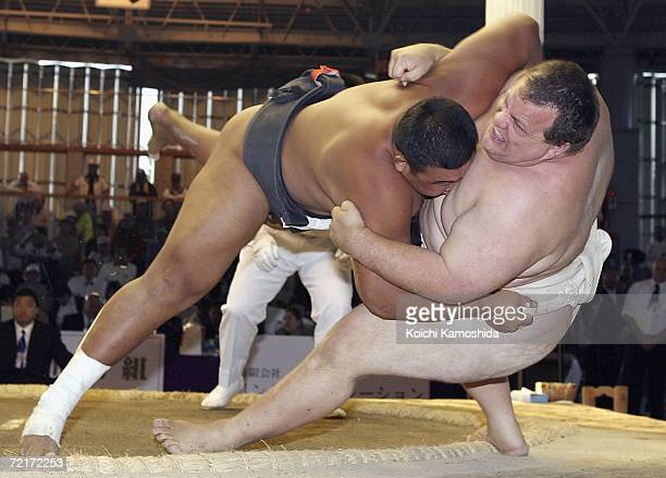 Byambajav Ulambayar of Mongolia throws Kelly Gneiting of United States in the Men's Heavyweight Division during the The 14th Sumo World Championships...