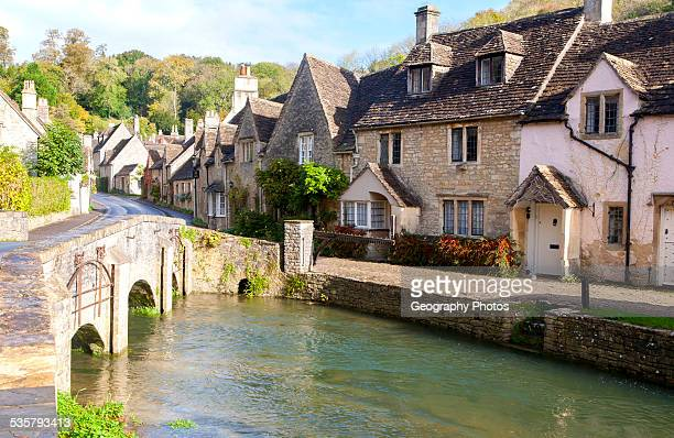Bybrook River running past stone cottages in Castle Combe Wiltshire England UK claimed to be Englands prettiest village