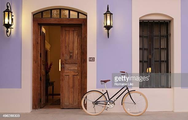 A bycicle at the entrance of a colonial house in Todos Santos Pueblo Magico Baja California Sur Mexico