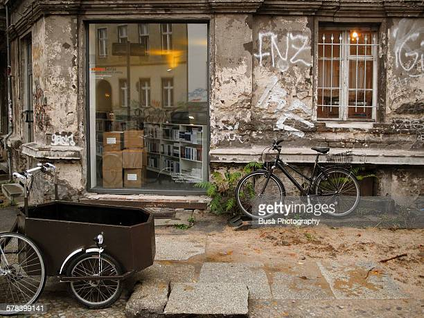 Bycicles leaning against a decrepit wall, Berlin