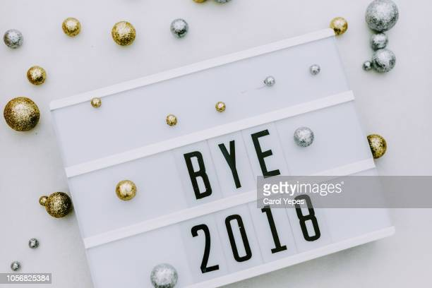 bye 201  message in lightbox with silver and golden decorations - 2018 stock pictures, royalty-free photos & images