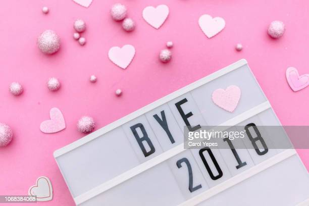 bye 2018 in lightbox.pink background - 2018 stock pictures, royalty-free photos & images