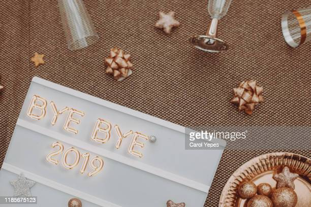 bye 2019  message in lightbox with silver and golden decorations - new year 2020 stock photos and pictures