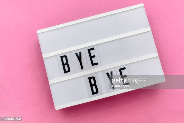 bye bye message in light box - leaving photos et images de collection