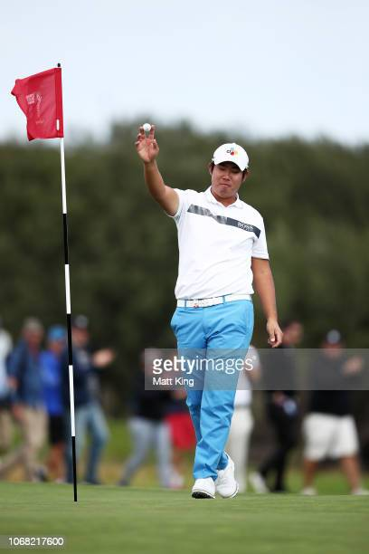Byeong Hun An of Korea celebrates a hole in one on the 15th hole during day two of the 2018 Australian Golf Open at The Lakes Golf Club on November...