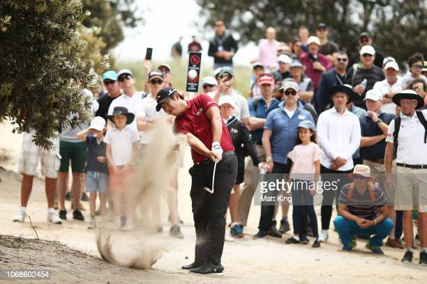 Byeong Hun An of Korea hits out of the sand on the 1st hole during day three of the 2018 Australian Golf Open at The Lakes Golf Club on November 17...