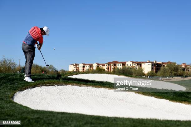 Byeong Hun An of Korea plays his second shot from the rough on the 13th hole during the third round of the Waste Management Phoenix Open at TPC...