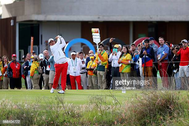 Byeong Hun An of Korea plays his shot from the first tee during the first round of men's golf on Day 6 of the Rio 2016 Olympics at the Olympic Golf...