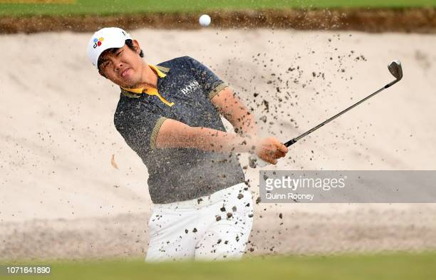 Byeong Hun An of Korea plays out of the bunker during day three of the 2018 World Cup of Golf at The Metropolitan on November 24 2018 in Melbourne...