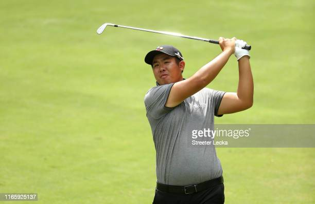 Byeong Hun An of South Korea hits a shot on the fifth hole during the third round of the Wyndham Championship at Sedgefield Country Club on August...