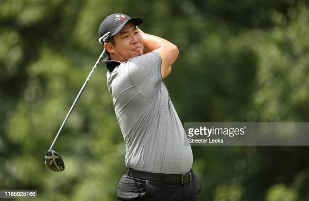 Byeong Hun An of South Korea hits a tee shot on the fifth hole during the third round of the Wyndham Championship at Sedgefield Country Club on...