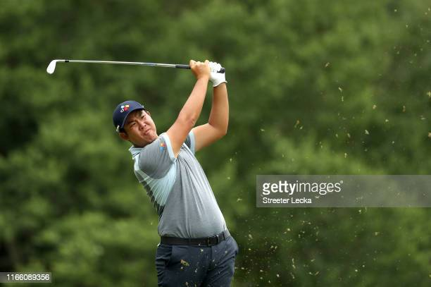 Byeong Hun An of South Korea hits a tee shot on the seventh hole during the final round of the Wyndham Championship at Sedgefield Country Club on...