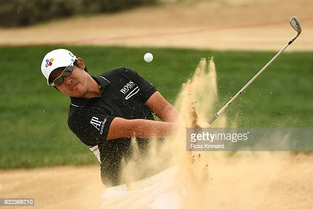 Byeong Hun An of South Korea plays from a bunker on the 8th hole during the final round of the Abu Dhabi HSBC Championship at Abu Dhabi Golf Club on...