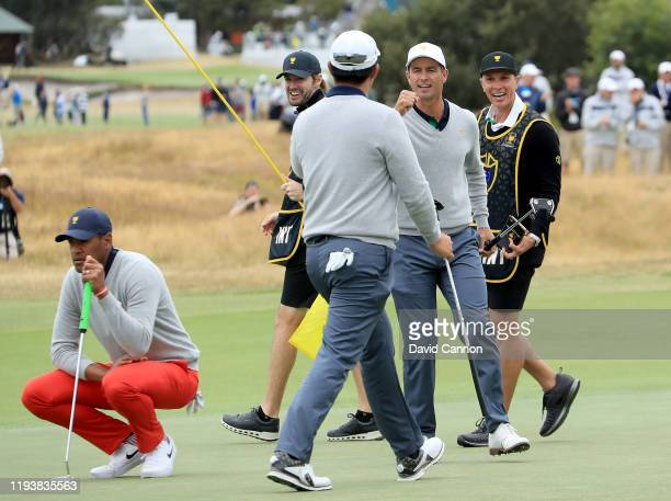 Byeong Hun An of the International Team celebrates holing a birdie putt on the 17th hole in his match with Adam Scott against Tony Finau and Matt...