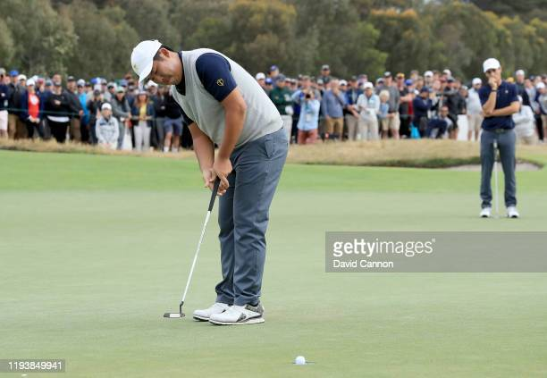 Byeong Hun An of the International Team hits a putt on the 17th hole in his match with Joaquin Niemann against Matt Kuchar and Tony Finau of the...