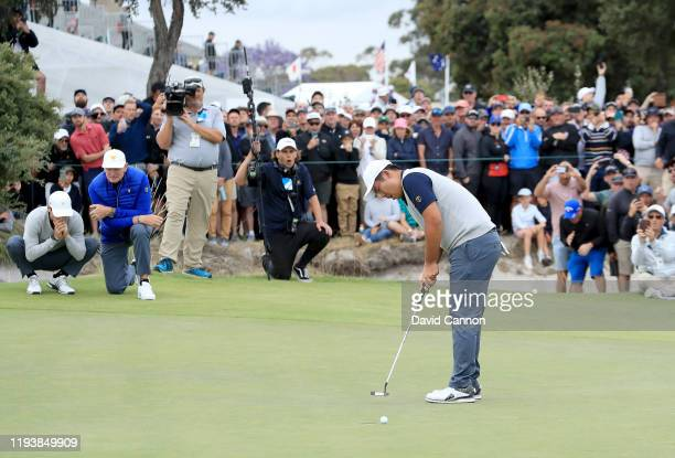 Byeong Hun An of the International Team hits a putt on the 18th hole just misses in his match with Joaquin Niemann against Matt Kuchar and Tony Finau...