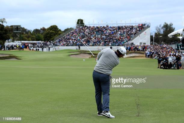 Byeong Hun An of the International Team plays his second shot on the 16th hole in his match with Adam Scott against Tony Finau and Matt Kuchar of the...