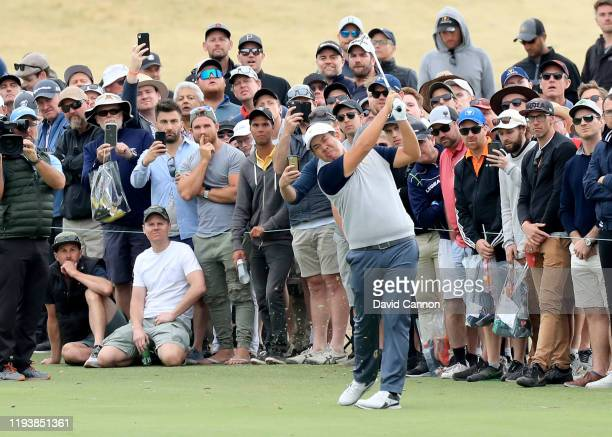 Byeong Hun An of the International Team plays his second shot on the 15th hole in his match with Joaquin Niemann against Matt Kuchar and Tony Finau...
