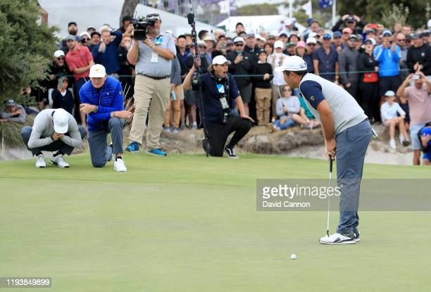 Byeong Hun An of the International Team reacts as his putt to win on the 18th hole just misses in his match with Joaquin Niemann against Matt Kuchar...