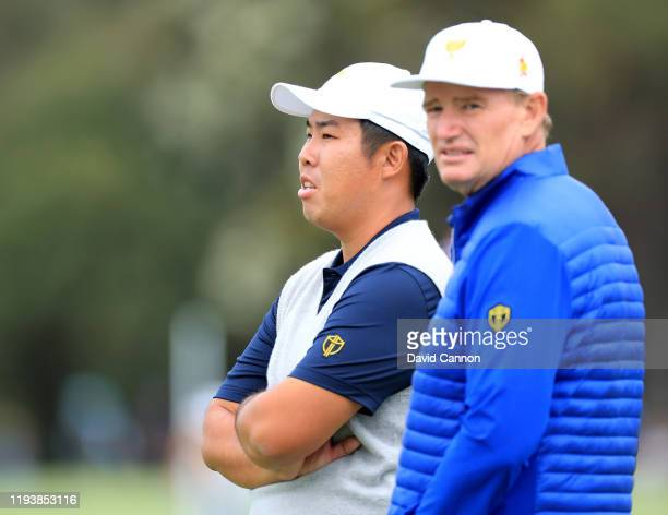 Byeong Hun An of the International Team watches with Ernie Els on the 18th hole in his match with Joaquin Niemann against Matt Kuchar and Tony Finau...