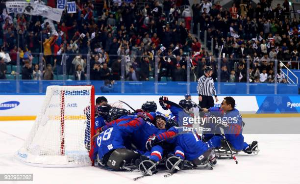 Byeong Seok Cho of Korea celebrate with his team mates after winning the bronze medal over Italy in the Ice Hockey bronze medal game between Korea...