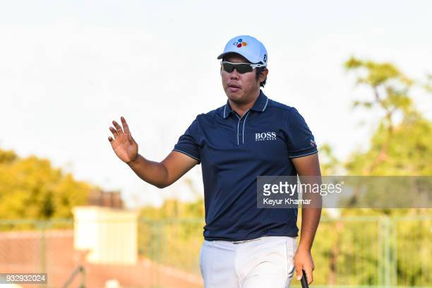 ByeongHun An of Korea waves to fans after making a birdie putt on the 17th hole green during the second round of the Arnold Palmer Invitational...