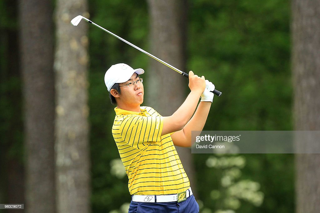 Byeong-Hun An of South Korea hits his second shot on the 11th hole during the first round of the 2010 Masters Tournament at Augusta National Golf Club on April 8, 2010 in Augusta, Georgia.