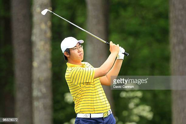 ByeongHun An of South Korea hits his second shot on the 11th hole during the first round of the 2010 Masters Tournament at Augusta National Golf Club...