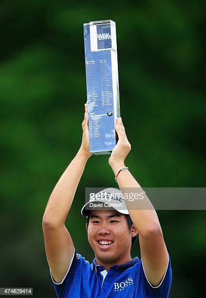 Byeong-Hun An of South Korea holds the trophy aloft following his victory during day 4 of the BMW PGA Championship at Wentworth on May 24, 2015 in...