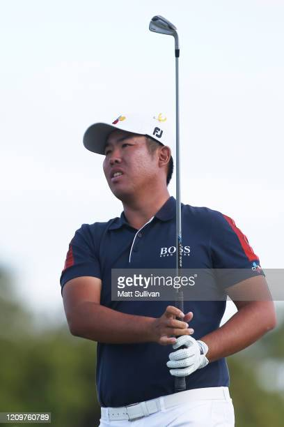 ByeongHun An of South Korea watches his tee shot on the 16th hole during the final round of the Honda Classic at PGA National Resort and Spa Champion...