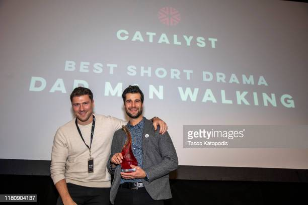 "Byrce Peg and John T O'Brien of ""Dad Man Walking"" win Best Short Drama at the Catalyst Content Awards Gala on October 13 2019 in Duluth Minnesota"
