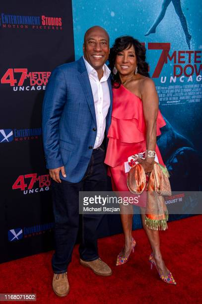 Byron Allen and Carolyn Folks attend the LA Premiere of 47 Meters Down UNCAGED on August 13 2019 in Los Angeles California