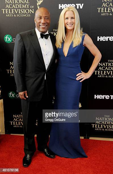 Byron Allen and Jennifer Lucas arrive at the 41st Annual Daytime Emmy Awards at The Beverly Hilton Hotel on June 22 2014 in Beverly Hills California