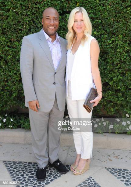 Byron Allen and Jennifer Lucas arrive at The Rape Foundation's Annual Brunch at a private residence on October 8 2017 in Los Angeles California