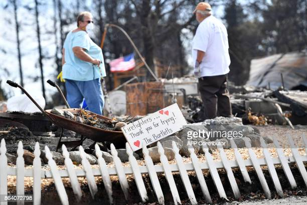 Byron and Joanne Bartlett search for remains at their burned residence in the Coffey Park area of Santa Rosa California on October 20 2017 Residents...