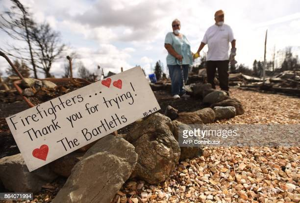 Byron and Joanne Bartlett stand on the grounds of their burned property in the Coffey Park area of Santa Rosa California on October 20 2017 Residents...