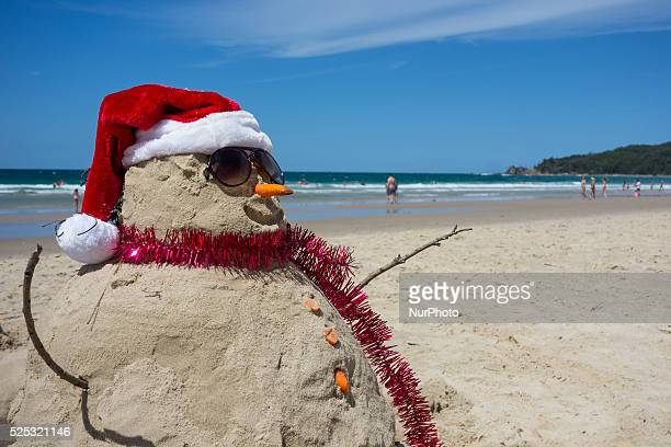 People enjoy the Christmas day in Byron Bay one of the most popular beach in Australia