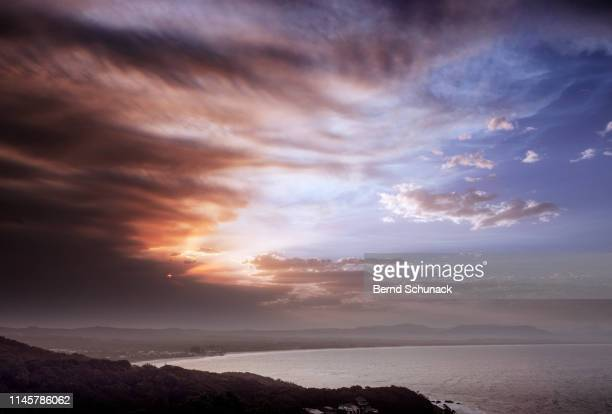 byron bay sunset - bernd schunack stock pictures, royalty-free photos & images
