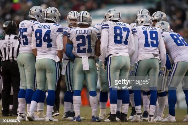 Byron Bell James Hanna Ezekiel Elliott Geoff Swaim Brice Butler and Jason Witten of the Dallas Cowboys huddle against the Philadelphia Eagles at...