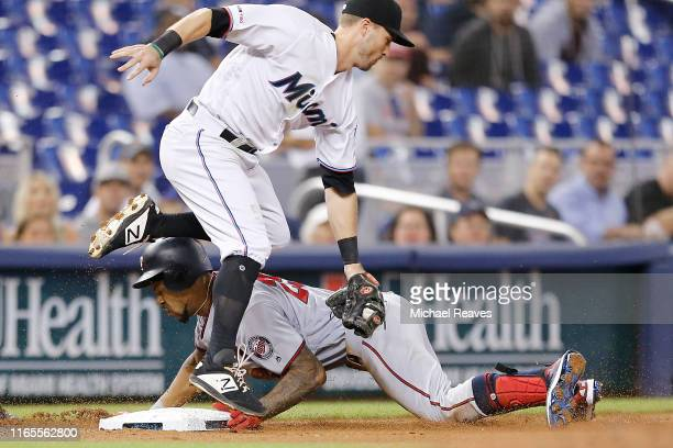 Byron Buxton of the Minnesota Twins advances to third after hitting a 2RBI double in the fourth inning against the Miami Marlins at Marlins Park on...