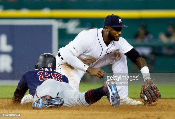Byron Buxton of the Minnesota Twins beats the throw to shortstop Niko Goodrum of the Detroit Tigers to stretch a hit into a double during the eighth...