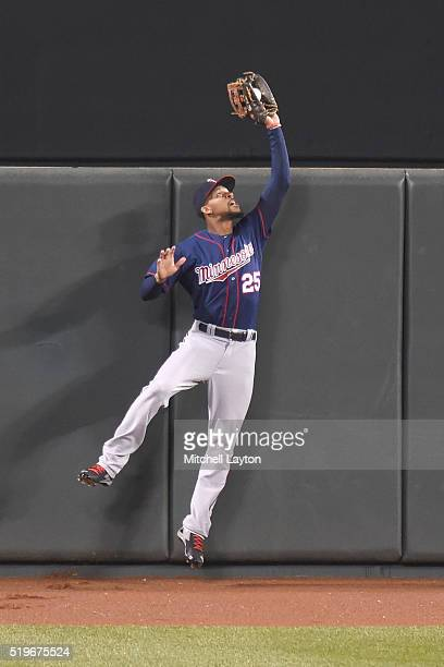 Byron Buxton of the Minnesota Twins catches a long fly ball hit by Jonathan Schoop of the Baltimore Orioles in the fifth inning during a baseball...