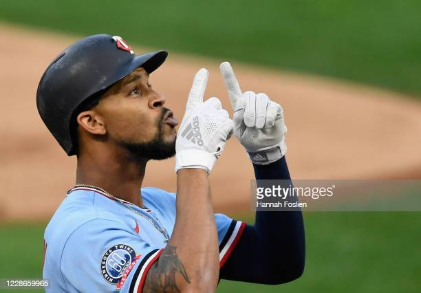 Byron Buxton of the Minnesota Twins celebrates a solo home run against the Detroit Tigers during the first inning of the game at Target Field on...