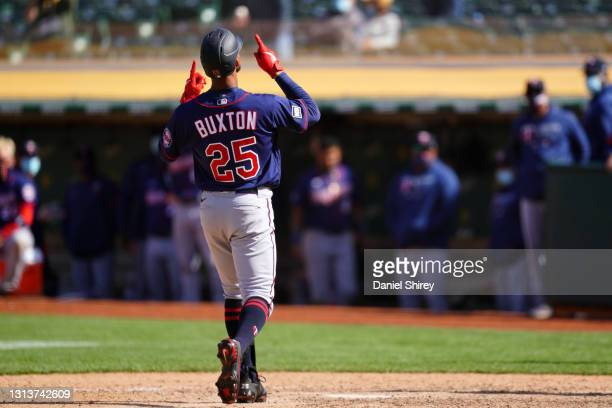 Byron Buxton of the Minnesota Twins celebrates a two-run home run during the tenth inning against the Oakland Athletics at RingCentral Coliseum on...