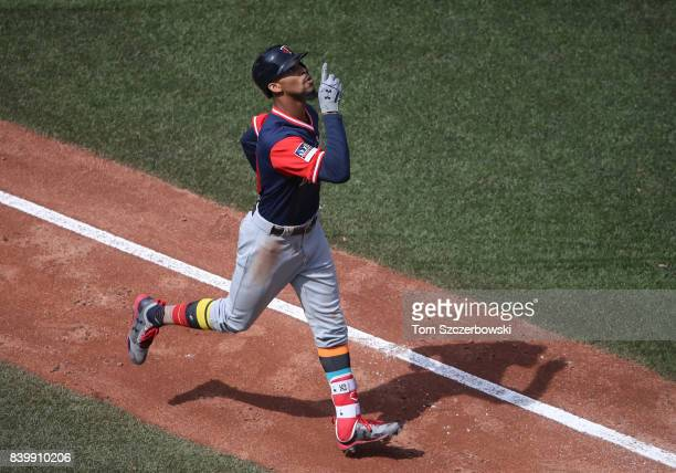 Byron Buxton of the Minnesota Twins celebrates after hitting a tworun home run in the fourth inning during MLB game action against the Toronto Blue...