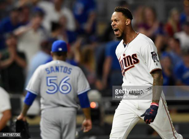 Byron Buxton of the Minnesota Twins celebrates as he rounds the bases after hitting a walkoff solo home run as Luis Santos of the Toronto Blue Jays...
