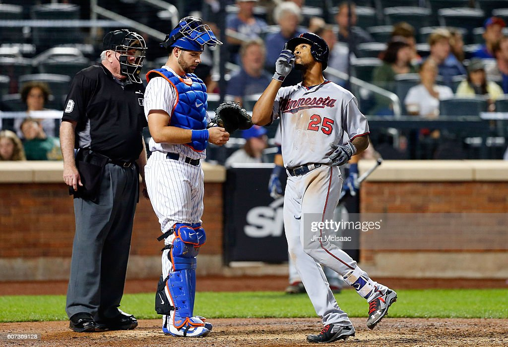 Byron Buxton #25 of the Minnesota Twins celebrates his eleventh inning home run as Kevin Plawecki #26 of the New York Mets looks on at Citi Field on September 17, 2016 in the Flushing neighborhood of the Queens borough of New York City.