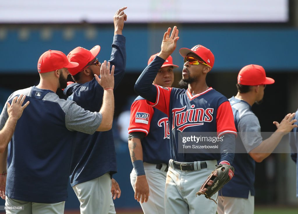 Byron Buxton #25 of the Minnesota Twins celebrates their victory with teammates during MLB game action against the Toronto Blue Jays at Rogers Centre on August 27, 2017 in Toronto, Canada.