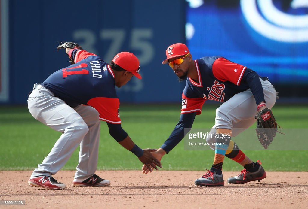Byron Buxton #25 of the Minnesota Twins celebrates their victory with Jorge Polanco #11 during MLB game action against the Toronto Blue Jays at Rogers Centre on August 27, 2017 in Toronto, Canada.