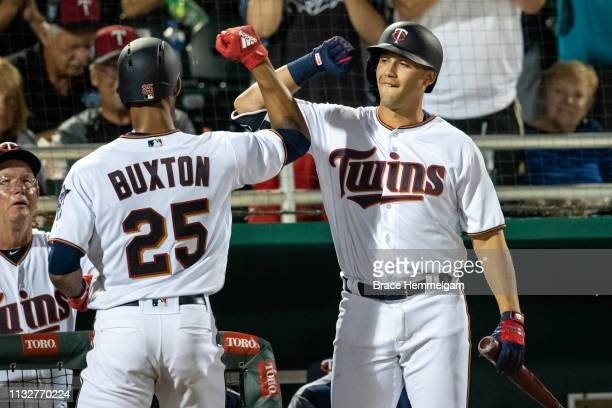 Byron Buxton of the Minnesota Twins celebrates with Alex Kirilloff during a spring training game against the Tampa Bay Rays on February 23 2019 at...